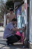 街道艺术家绘画 库存照片