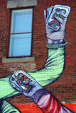 街道艺术纸牌运动员手 免版税库存图片