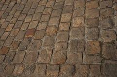 街道路面特写镜头由石头块做成在巴黎 图库摄影