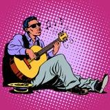 街道非裔的蓝色音乐家与a的 免版税库存照片