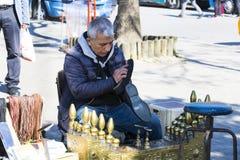 街道鞋子擦净剂在市伊斯坦布尔在土耳其 免版税图库摄影