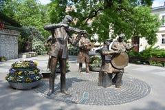街道音乐家纪念品在华沙 免版税库存照片