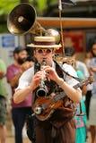 街道音乐家老牌 库存图片