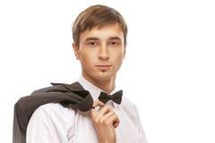 衣服和蝶形领结的年轻人 免版税库存图片