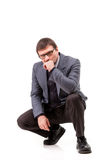 衣服和玻璃的一个英俊的人,认为;白色背景 免版税图库摄影