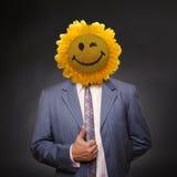 衣服外套的微笑的向日葵顶头人 库存图片