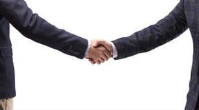 衣服的两个人握手 免版税库存图片