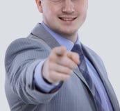 衣服的年轻商人指向与他的手指的 免版税库存图片