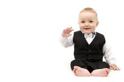 衣服的愉快的男婴 免版税图库摄影