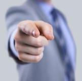 衣服的指向与他的手指的一个商人的身体 库存图片