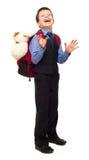 衣服的男孩与背包 免版税库存照片