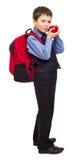 衣服的男孩与背包 库存照片