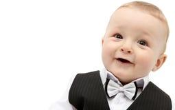 衣服的美丽的男婴 免版税库存图片
