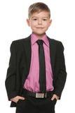 黑衣服的英俊的年轻男孩 免版税库存照片