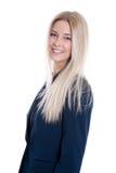 衣服的被隔绝的年轻白肤金发的微笑的女实业家在白色b 免版税库存图片