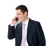 衣服的年轻商人谈话在巧妙的电话 免版税库存照片