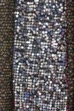 衣服饰物之小金属片纺织品 免版税库存图片