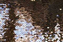 衣服饰物之小金属片-闪耀的闪光金属片的纺织品 库存照片