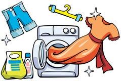 洗衣机和干净的衣裳 免版税库存图片