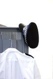 衣物柜警察 免版税库存图片