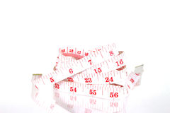 衣物测量的磁带螺旋 库存图片