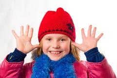 衣裳打扮了快乐的女孩矮小个俏丽的冬天 免版税库存照片