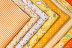 补缀品的黄色织品 免版税库存图片