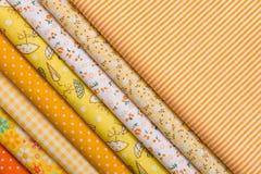 补缀品的黄色织品 免版税库存照片