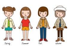代表四件季节衣裳动画片的四个女孩 免版税库存照片