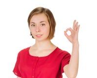 表明好标志的少妇 免版税库存照片