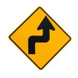 表明锋利的曲线的路标 免版税库存图片