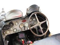 仪表板和方向盘在白色背景隔绝的意大利经典跑车内部  免版税库存图片