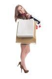 表现出购物的妇女喜悦 库存图片