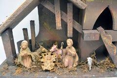 代表耶稣的诞生图在饲槽 免版税图库摄影