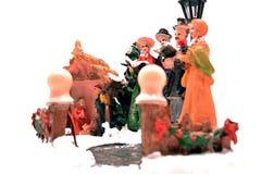代表耶稣诞生在白色背景隔绝的小雕象 免版税库存图片