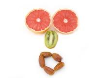 表达式开放果子的嘴 库存照片