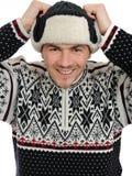 表达式滑稽的帽子听的人温暖的冬天 库存图片