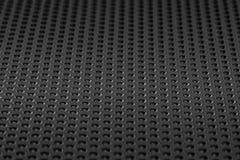 黑表面无光泽的金属网现代样式背景 免版税图库摄影