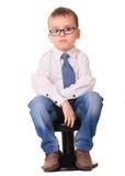 衬衣和牛仔裤的哀伤的男孩 图库摄影