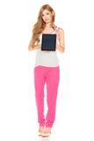 衬衣和裤子的女孩有片剂计算机的 库存照片