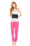 衬衣和裤子的女孩有片剂计算机的 库存图片