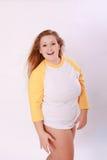 衬衣的曲线美白肤金发的女孩 图库摄影