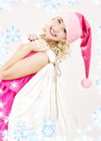 袋子大快乐的女孩辅助工圣诞老人 免版税库存照片