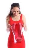 袋子愉快的当前红色惊奇妇女年轻人 库存照片