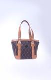 袋子或棕色皮革妇女提包在背景 库存照片