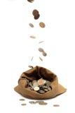 袋子硬币下跌的飞行 免版税库存图片