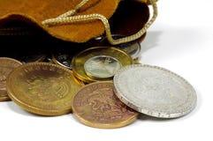 袋子硬币 图库摄影