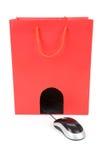 袋子计算机鼠标购物 图库摄影
