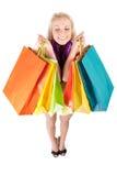 袋子购物的妇女年轻人 免版税库存照片