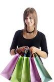 袋子购物的少年 免版税库存照片